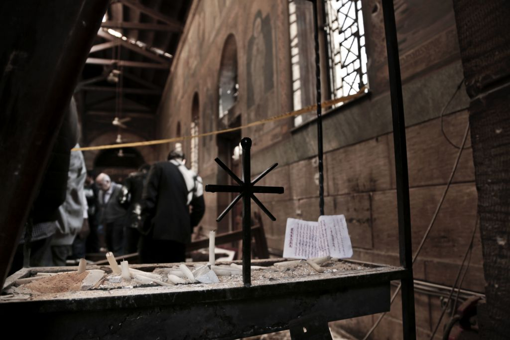 Security forces examine the scene inside the St. Mark Cathedral in central Cairo, following a bombing, Sunday, Dec. 11, 2016. (AP Photo/Nariman El-Mofty)