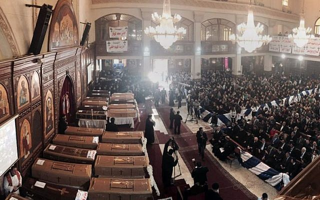 People attend a funeral service for victims of a Sunday cathedral bombing, at the Virgin Mary Church, in Cairo, Egypt, Monday, Dec. 12, 2016. (AP Photo/Nariman El-Mofty)