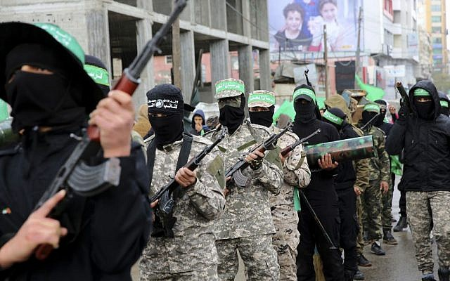 Masked Palestinian terrorists from the Izzedine al-Qassam Brigades, a military wing of Hamas, commemorate the 29th anniversary of their group, in Gaza City, Wednesday, Dec. 14, 2016.  (AP Photo/Adel Hana)