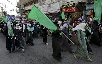 Palestinian Hamas supporters hold green Islamic flags during a rally to commemorate the 29th anniversary of the founding of the Hamas militant group, in Gaza City, Wednesday, Dec. 14, 2016. (AP Photo/Adel Hana)