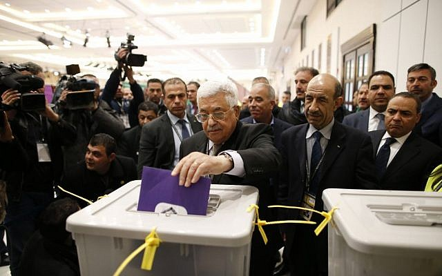 Palestinian Authority president Mahmud Abbas casts a vote at the Muqataa, the Palestinian Authority headquarters, in the city of Ramallah, West Bank, December 3, 2016. (Ahmad Gharabli/Pool photo via AP)