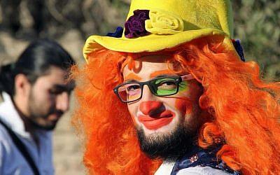 This undated photo shows Syrian social worker Anas al-Basha, 24, dressed as a clown, while posing for a photograph in Aleppo, Syria. (Courtesy of Ahmad al-Khatib, via AP)