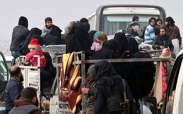 This image shows residents of eastern Aleppo arriving in western rural Aleppo, Syria, Friday, Dec. 16, 2016, as part of an evacuation deal. (Aleppo 24 via AP)