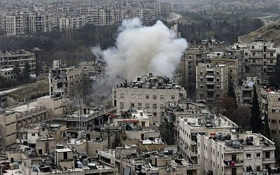 Smoke rises after rebel fighters launch a mortar shell on a residential neighborhood in west Aleppo, Syria, Monday, December 5, 2016. (AP Photo/Hassan Ammar)