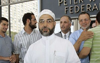 In this Thursday, Sept. 4, 2008 file photograph, Imam Mohammad Qatanani, center left, walks out of the Peter W. Rodino Jr. Federal Building in Newark, New Jersey, with supporters after an immigration judge ruled that Qatanani can remain in the United States. (AP Photo/Mike Derer, file)