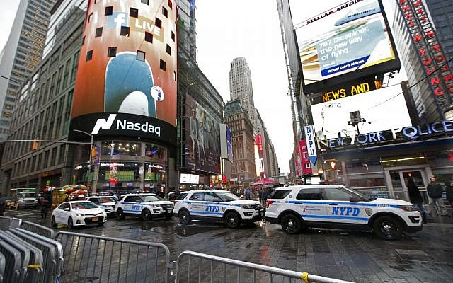A row of New York City police cars is parked along a street in Times Square, Thursday, December 29, 2016, in New York. (AP/Kathy Willens)