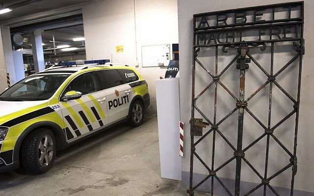 """The iron gate from the former Nazi concentration camp in Dachau, southern Germany, with the slogan """"Arbeit macht frei"""" (""""Work will set you free"""") is displayed Saturday Dec. 3, 2016, after being found earlier this week by police in Bergen, Norway. (Marit Hommedal / NTB scanpix via AP)"""