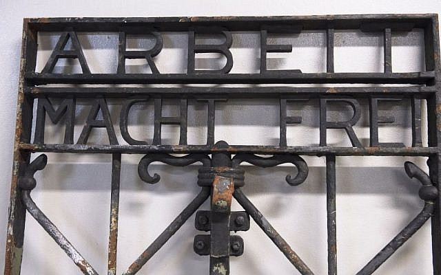 The iron gate from the former Nazi concentration camp in Dachau, southern Germany, with the slogan 'Arbeit macht frei' ('Work will set you free') is displayed Saturday Dec. 3, 2016, after being found earlier this week by police in Bergen, Norway. (Marit Hommedal/NTB scanpix via AP)