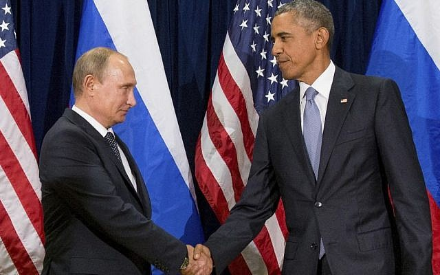 In this Sept. 28, 2015 file photo, President Barack Obama shakes hands with Russian President President Vladimir Putin before a bilateral meeting at United Nations headquarters. Obama has ordered intelligence officials to conduct a broad review on the election-season hacking that rattled the presidential campaign (AP Photo/Andrew Harnik, File)