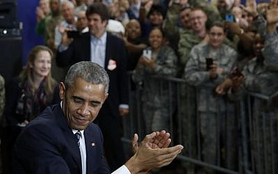 President Barack Obama turns to leave after speaking to and greeting service members at MacDill Air Force Base in Tampa, Fla., Tuesday, Dec. 6, 2016 (AP Photo/Carolyn Kaster)