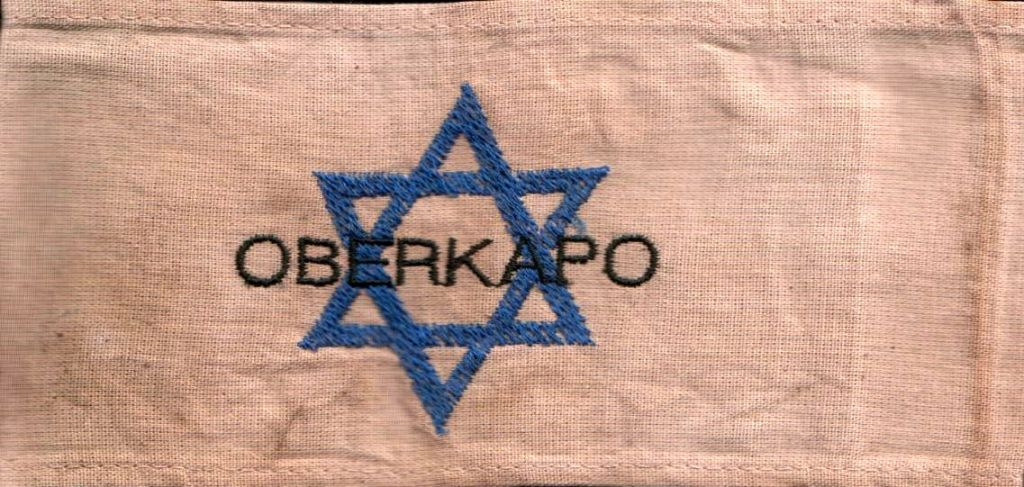 A Holocaust-era 'Kapo' leader armband, worn by a Jewish inmate tasked with administrative functions. (Public domain)