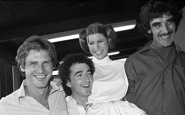From left, Star Wars actors Harrison Ford (Han Solo), Anthony Daniels (C-3PO), Carrie Fisher (Leia Organa) and Peter Mayhew (Chewbacca) take a break from filming a television special in Los Angeles, October 5, 1978. (AP/George Brich)