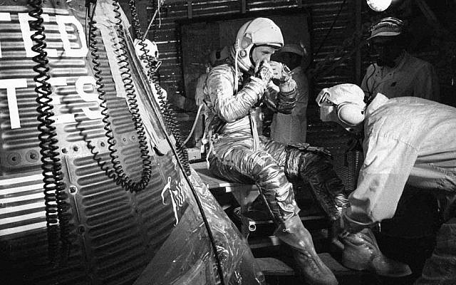 In this Feb. 20, 1962, file photo, astronaut John Glenn sits next to the Friendship 7 space capsule atop an Atlas rocket at Cape Canaveral, Fla., during preparations for his flight which made him the first American to orbit the Earth. (AP)