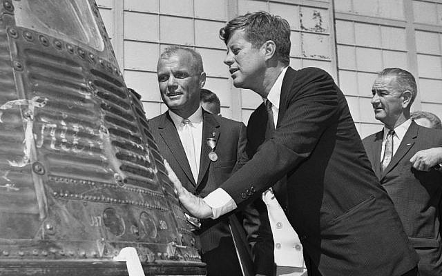 In this Feb. 23, 1962 file photo, astronaut John Glenn and President John F. Kennedy inspect the Friendship 7, the Mercury capsule in which Glenn became the first American to orbit the Earth. (AP/Vincent P. Connolly)