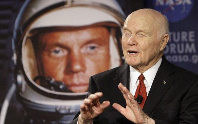 """In this Feb. 20, 2012, file photo, US Sen. John Glenn talks with astronauts on the International Space Station via satellite before a discussion titled """"Learning from the Past to Innovate for the Future"""" in Columbus, Ohio. (AP/Jay LaPrete)"""