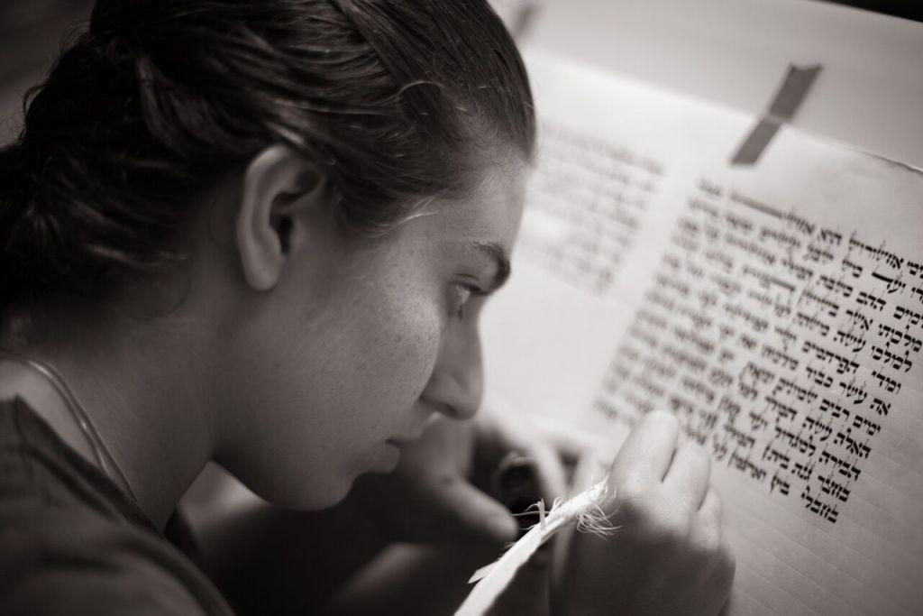 Rachel Jackson scribing her Megillat Esther. (Courtesy)