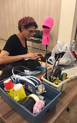 Rachel Jacobson sewing a puppet for the J-Town Playhouse production of Avenue Q on November 30, 2016. (Photo by Chana Singer).