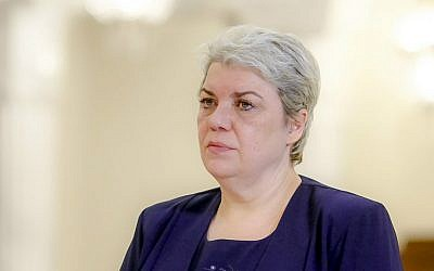 In this photo taken May 20, 2015, Sevil Shhaideh, 52, stands at the Romanian presidency before being sworn in as regional development minister in Bucharest, Romania. (AP Photo/Octav Ganea)