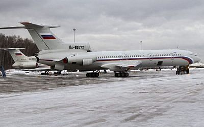 This photo taken on Thursday, January 15, 2015 shows the Tu-154 plane with registration number RA-85572, foreground, at Chkalovsky military airport near Moscow, Russia. (AP Photo/Dmitry Petrochenko)