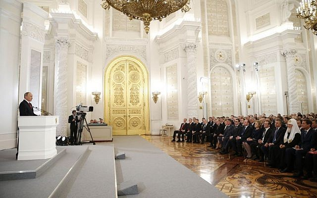 Russian President Vladimir Putin, left, gives his annual state of the nation address in the Kremlin in Moscow, Russia, December 1, 2016. (Dmitry Astakhov/ Sputnik, Government Press Service Pool photo via AP)