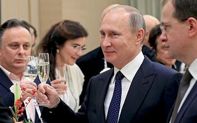 In this photo taken Friday, Dec. 2, 2016 Russian President Vladimir Putin toasts at a meeting with Russian and foreign cultural figures in the Mariinsky Theater in St. Petersburg, Russia.  (Mikhail Klimentyev/Sputnik, Kremlin Pool Photo via AP)
