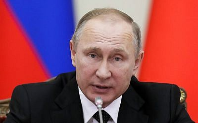 In this Monday, Dec. 26, 2016 file photo Russian President Vladimir Putin speaks at the meeting in St.Petersburg, Russia. President Vladimir Putin said, Friday, Dec. 30, 2016 that Russia will not be expelling US diplomats in response to a new round of US sanctions. (AP Photo/Dmitri Lovetsky, File)