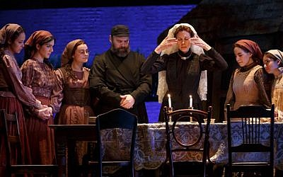 Candlelighting for Shabbat in the current Broadway production of 'Fiddler on the Roof.' Jessica Hecht (center) plays Golde. (Joan Marcus)