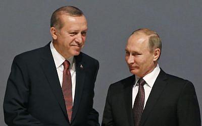 Turkey's President Recep Tayyip Erdogan, (l) and Russian President Vladimir Putin shake hands in Istanbul, Turkey, Oct. 10, 2016.  (AP Photo/Emrah Gurel)