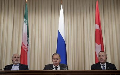 Iranian Foreign Minister Mohammad Javad Zarif, left, Russian Foreign Minister Sergey Lavrov, center, and Turkey's Foreign Minister Mevlut Cavusoglu, attend a joint news conference on December 20, 2016, after their talks in Moscow, Russia. (AP Photo/Pavel Golovkin, File)