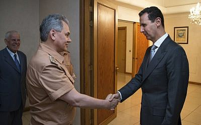 Syrian President Bashar Assad, right, shakes hands with Russian Defense Minister Sergei Shoigu in Damascus, Syria, June 18, 2016. (Vadim Savitsky/ Russian Defense Ministry Press Service pool photo via AP, File)