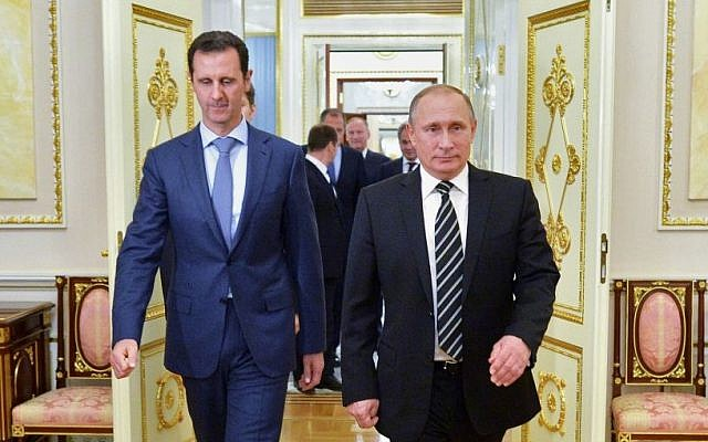 File: Russian President Vladimir Putin, right, and Syria President Bashar Assad arrive for a meeting in the Kremlin in Moscow, Russia, October 20, 2015. (Alexei Druzhinin, RIA-Novosti, Kremlin Pool Photo via AP, File)