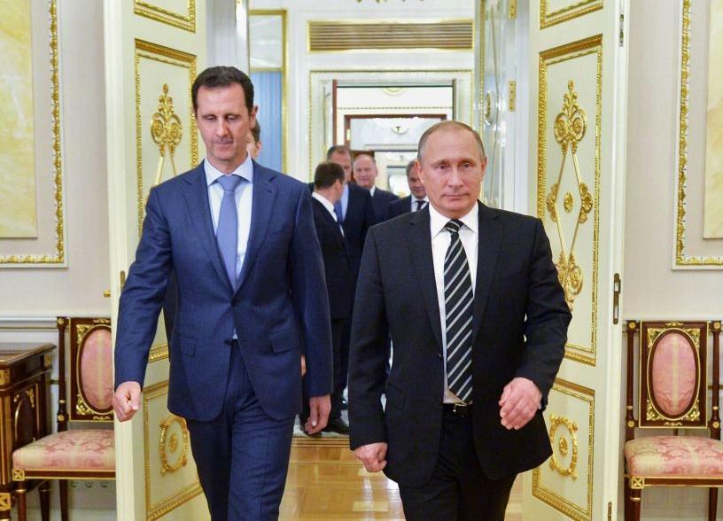 File: Russian President Vladimir Putin, right, and Syria President Bashar Assad arrive for a meeting in the Kremlin in Moscow, Russia, October 20, 2015. (Alexei Druzhinin, RIA-Novosti, Kremlin Pool Photo via AP, File)