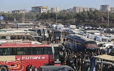 Syrians evacuated from the embattled Syrian city of Aleppo during a ceasefire arrive at a refugee camp in Rashidin, near Idlib, Syria, December 20, 2016. (AP)