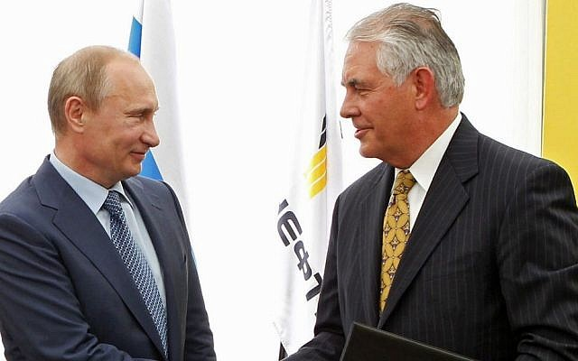 In this June 15, 2012, file photo, Russian President Vladimir Putin, left, and ExxonMobil CEO Rex Tillerson shake hands at a signing ceremony of an agreement between state-controlled Russian oil company Rosneft and ExxonMobil at the Black Sea port of Tuapse, southern Russia. (Mikhail Klimentyev/RIA-Novosti, Presidential Press Service via AP, Pool, File)