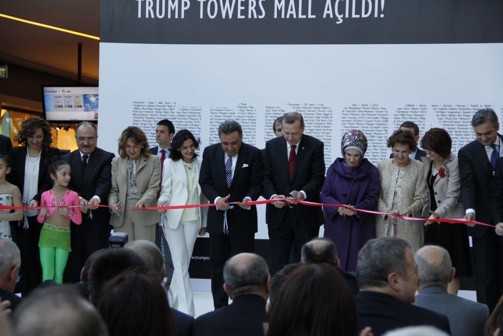 Dogan Holding founder Aydin Dogan (center), Turkish President Recep Tayyip Erdogan and Mehmet Ali Yalcindag (far right) at opening of Trump Towers in Istanbul in April 2012. (Public domain, Voice of America via Wikimedia Commons)