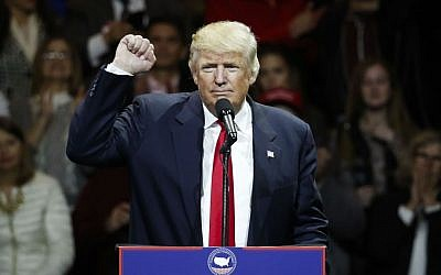 President-elect Donald Trump raises his fist as he speaks during the first stop of his post-election tour, Thursday, Dec. 1, 2016, in Cincinnati, Ohio. (AP Photo/John Minchillo)