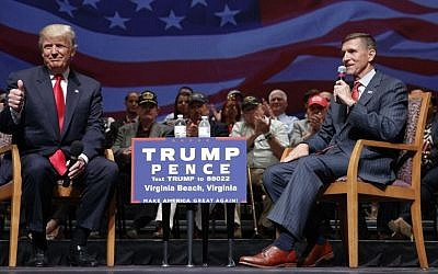 In this Sept. 6, 2016, file photo, then Republican presidential candidate Donald Trump gives a thumbs-up as he speaks with retired Lt. Gen. Michael Flynn during a town hall in Virginia Beach, Va. (AP Photo/Evan Vucci)