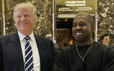 President-elect Donald Trump and Kanye West pose for a picture in the lobby of Trump Tower in New York, December 13, 2016. (AP Photo/Seth Wenig)