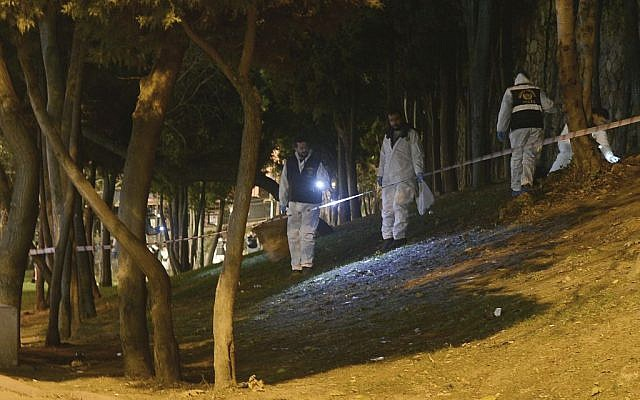 Forensic officials work at the scene of explosions near the Besiktas football club stadium after attacks in Istanbul, December 10, 2016. (Ismail Coskun, IHA via AP)