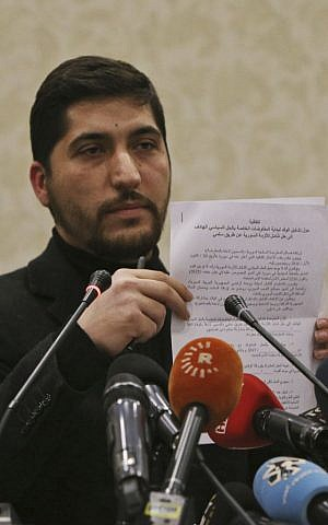 Osama Abu Zeid of the the main moderate Syrian opposition group Free Syrian Army, shows what he said is a copy of the five-point cease-fire agreement for Syria, during a news conference in Ankara, Turkey, Thursday, December 29, 2016. (AP/Burhan Ozbilici)