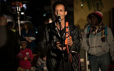 Bereket Tekle of the Yatana Band performs at the Nightlight Festival in the neighborhood of Neve Sha'anan in Tel Aviv, December 24, 2016. (Luke Tress/Times of Israel)