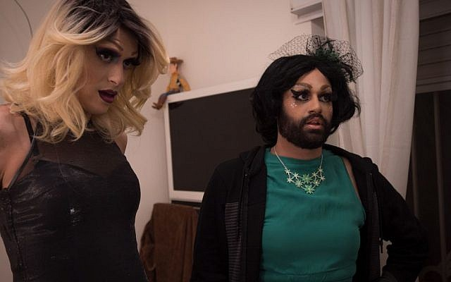 Israeli drag queens Yosale (left) and Noir Styrofoam (right) take a last look in the mirror before heading to a performance at the Videopub in Jerusalem. (Luke Tress/Times of Israel)