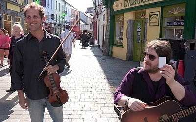 Daniel Hoffman (left) playing with local band The Rascals on the streets of Galway, Ireland (Courtesy Daniel Hoffman)