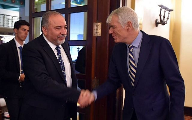 Defense Minister Avigdor Liberman (left) shakes hands with EU ambassador Lars Faaborg Anderson during a meeting on December 7, 2016. (Ariel Hermoni/Defense Ministry)