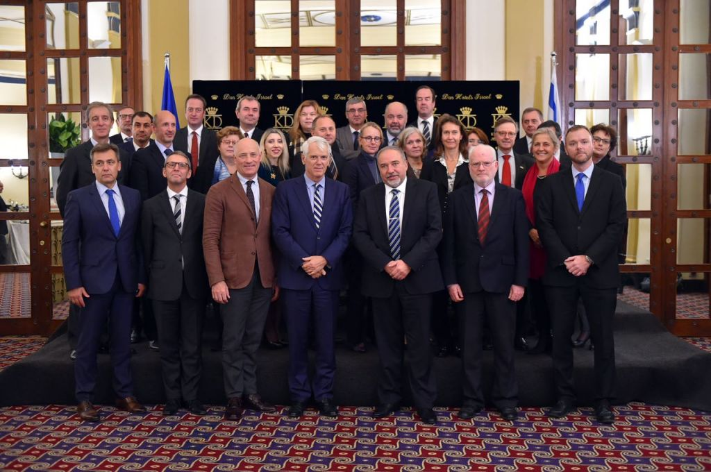 Defense Minister Avigdor Liberman poses for a photograph with European Union ambassadors to Israel during a meeting on December 7, 2016. (Ariel Hermoni/Defense Ministry)