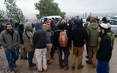 Protesters in Amona on December 18, 2016. (Judah Ari Gross/Times of Israel)