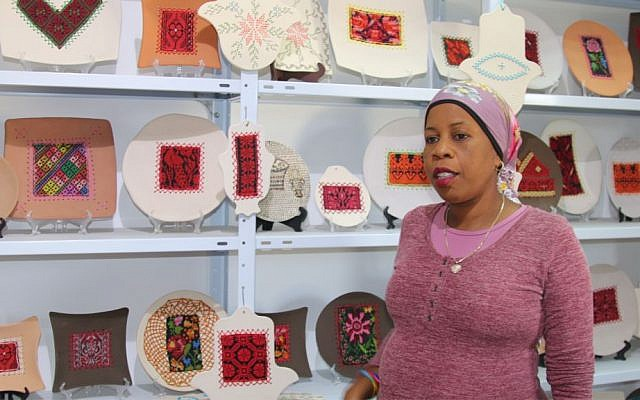 Zenab Garabia in her gallery in Segev Shalom. Garabia specializes in pottery with traditional Bedouin designs. (Shmuel Bar-Am)