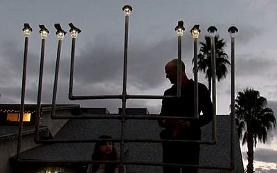 A restored menorah is re-lit outside the Ellis family home in Chandler, Arizona, December 30, 2016 (ABC15 / YouTube screenshot)