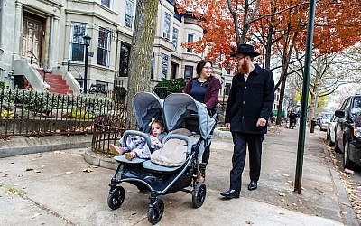 Rabbi Mendel Alperowitz and wife Mussie strolling with their two daughters in Brooklyn, Nov. 25, 2016. (Chabad.org/JTA)