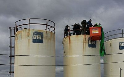 Protesters gather atop a water tower in Amona on December 15, 2016. (Judah Ari Gross/ Times of Israel)